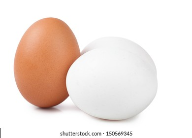 Macro view of brown and white eggs on the white background