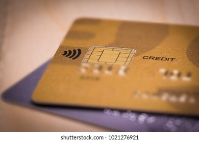 Macro view of contactless icon on a credit card. Electronic payment and business concept.