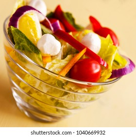 Macro view of fresh Spring Summer Salad in Glass Bowl