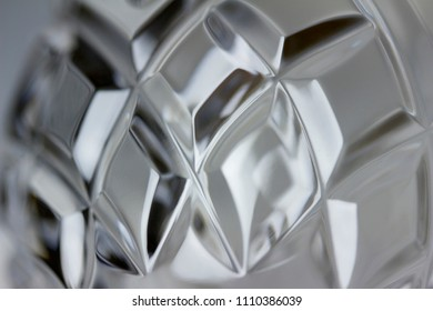 Macro view of glowing hand cut lead crystal glass facets