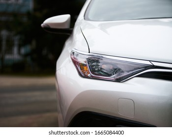 Macro view of modern white car lamp headlight.