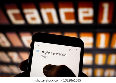 Macro view on smartphone screen at airport. Typing finger. Flight cancelled pop up on calendar. Schedule app, cancel flight, booking and insurance concept. Travel and holidays topic. Vintage style