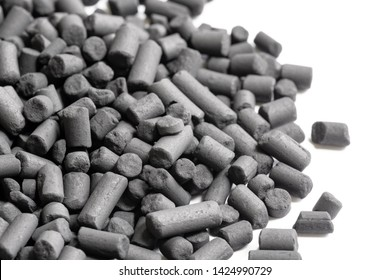 Macro view of small activated Carbon granules seen in a heap. Used in purification, pharmaceutical and industrial uses. Showing the microporous structure of the granules themselves.