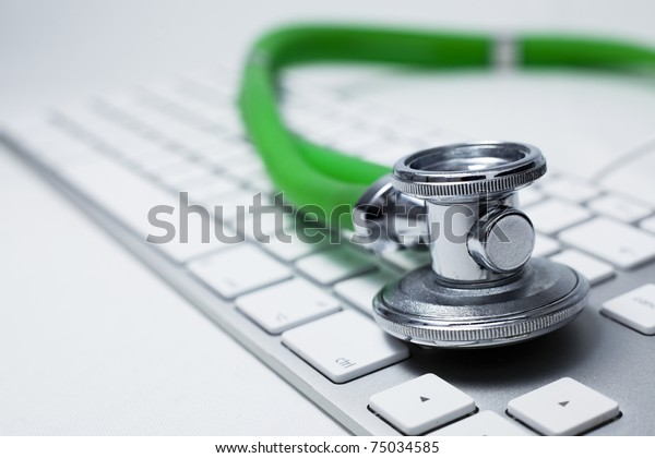Macro view of a stethoscope on computer keyboard.