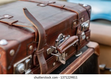 Macro view of Vintage leather suitcase with chrome clasps