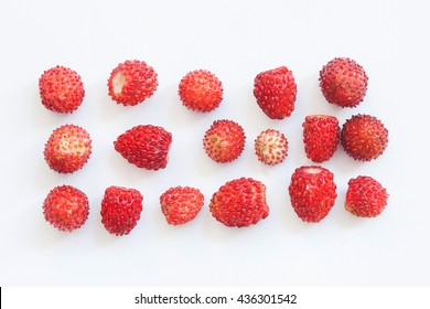 Macro view wild strawberry on white background. Forest berries in rectangular shape form. Shallow depth of field. Selective focus