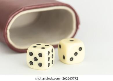 Macro white dice isolated on white background