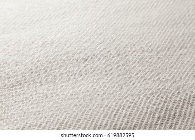 macro of white woven texture with selective focus