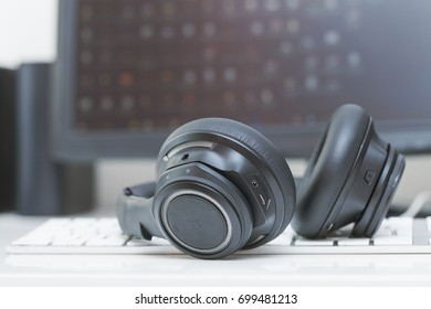 macro wireless bluetooth over-the-ear headphones on computer keyboard