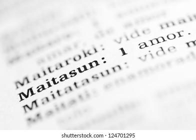"macro of the word ""Maitasun"" written in a Basque dictionary"