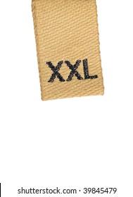 Macro of XXL size clothing label, isolated