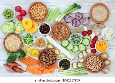 Macrobiotic health food concept with soba and udon noodles, miso, tofu, kuchika tea, wasabi nuts, vegetables, whole wheat pasta, legumes and grains with foods high in protein, antioxidants & vitamins.