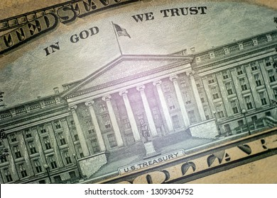 Macro.Part of the ten-dollar US bill on the reverse side. Image of the US Department of the Treasury Building and the inscription In God we trust. Close-up. High detail texture. Selective focus