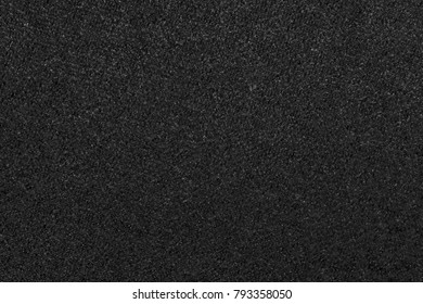 the macrophotography of fabric of a velvet of black color for the abstract textured background or for wallpaper