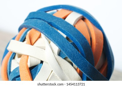 macrophotography of rubber bands in different colors in sphere shape