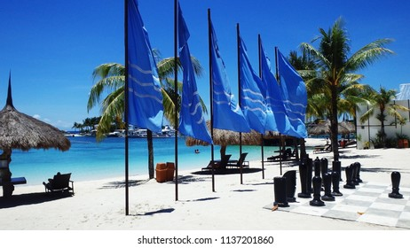 Mactan, Cebu / Philippines - 10 12 2015: Looking at the beachfront of a resort in Cebu with beautiful blue water