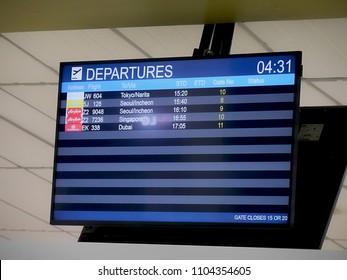 MACTAN ISLAND, CEBU, PHILIPPINES--MARCH 2018: Ddepartures flight status board at one of the gates at the Mactan-Cebu International Airport.