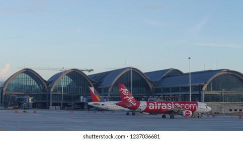 MACTAN ISLAND, CEBU, PHILIPPINES--MARCH 2018: An Air Asia Airlines and Philippine Airlines aircraft on standby at the the Mactan-Cebu International Airport.