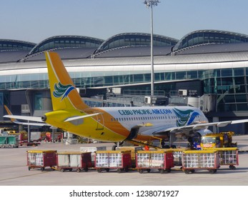 MACTAN ISLAND, CEBU, PHILIPPINES--MARCH 2018: A Cebu Pacific Airlines aircraft loads passengers and cargo at the the Mactan-Cebu International Airport.