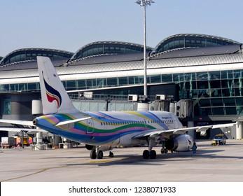 MACTAN ISLAND, CEBU, PHILIPPINES--MARCH 2018: A Bangkok Air aircraft loads passengers and cargo at the the Mactan-Cebu International Airport.