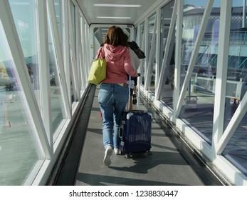 MACTAN ISLAND, CEBU, PHILIPPINES--MARCH 2018: Passengers going through a jetway to board an aircraft at the Mactan-Cebu International Airport.