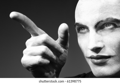 Mad angry funnyman pointing finger. Black and white photo. Artistic darkness added