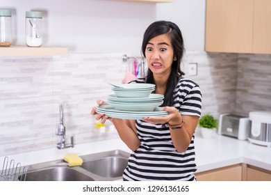 mad asian woman hate to do some chores. housewife hate washing dish