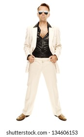 Mad disco dancer in white suit and snake leather boots with selfconfident appearance