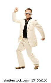 Mad disco dancer in white suit and snake leather boots, isolated on white