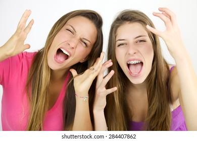 Mad female teenager shouting loud desperate