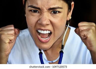 Mad Latina Female Nurse Medical Professional Wearing Scrubs