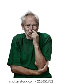 Mad looking senior male picks his nose. Grunge darkened portrait isolated on white background
