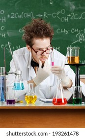 Mad professor thinks about the result of the experiment in his laboratory
