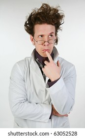 Mad scientist or crazy doctor in lab coat, glasses, spiked hair.