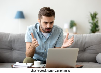 Mad stressed young man angry about stuck laptop or pc failure, furious guy annoyed with computer problem virus, user confused by fake bad online news, frustrated with notebook breakdown or data loss