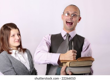 Mad teacher holding books and  screaming loud at the camera and teen age girl making disappointing face looking at him
