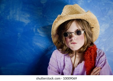 Mad Young Girl Wearing a Straw Cowboy Hat and Funny Sunglasses