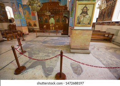 Madaba, Jordan - August 18, 2012: Interior of Greek Orthodox Basilica of St George with the mosaic map of Holy Land in Madaba, Jordan.