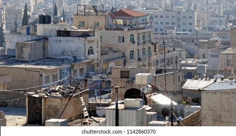 Madaba, Jordan, March 11, 2018: View into the untidy backyards of the city in the middle east