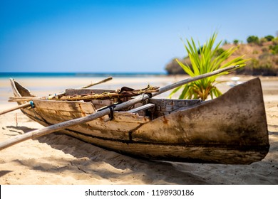 Madagascan pirogue boat on the beach on Nosy Be, Madagascar. Blurred background.