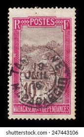 MADAGASCAR - CIRCA 1915: a stamp printed in Madagascar shows the transportation by sedan chair, circa 1915