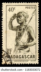 MADAGASCAR - CIRCA 1946: A stamp printed by Madagascar, shows spear-bearing dancer from southern Madagascar, people and animals definitive Issue circa 1946