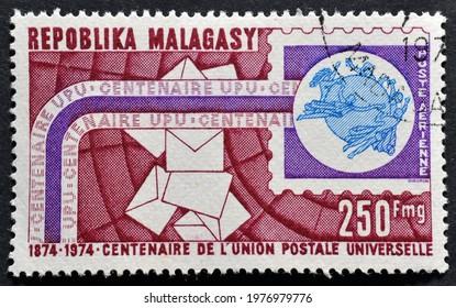 Madagascar - circa 1974 : Cancelled postage stamp printed by Madagascar, that shows UPU emblem celebrating centenary circa 1974.