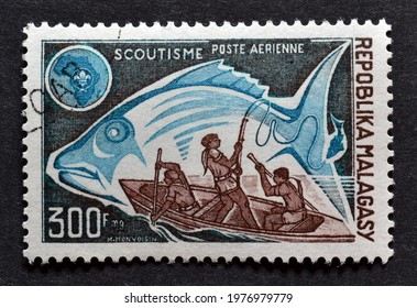 Madagascar - circa 1974 : Cancelled postage stamp printed by Madagascar, that shows Scouts fishing, circa 1974.