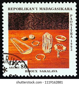 "MADAGASCAR - CIRCA 1994: A stamp printed in Madagascar from the ""Handicraft"" issue shows Silver jewellery on table, Sakalava, circa 1994."