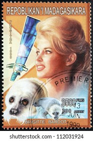 MADAGASCAR - CIRCA 1999. A postage stamp printed by Madagascar shows image portrait of former French fashion model, actress and animal rights activist Brigitte Bardot, circa 1999.