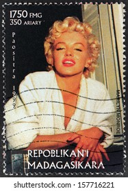 MADAGASCAR - CIRCA 1999: A postage stamp printed by MADAGASCAR shows image portrait of famous American actress, model and singer Marilyn Monroe (1926-1962), circa 1999.