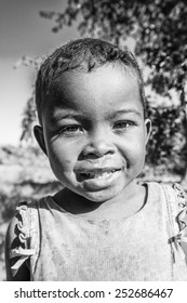 MADAGASCAR - JULY 3, 2011: Portrait of an unidentified beautiful smiling little girl in Madagascar, July 3, 2011. Children of Madagascar suffer of poverty due to the unstable situation.