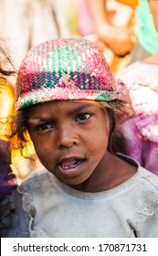 MADAGASCAR - JUNE 30, 2011: Portrait of an unidentified angry little girl in Madagascar, June 30, 2011. People of Madagascar suffer of poverty due to the unstable situation.