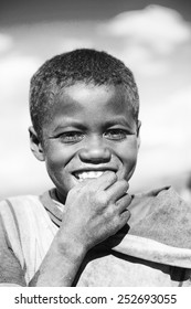 MADAGASCAR - JUNE 30, 2011: Portrait of an unidentified ilittle boy in the field in Madagascar, June 30, 2011. People of Madagascar suffer of poverty due to the unstable situation.
